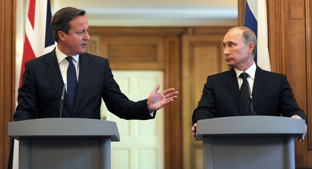 British Prime Minister David Cameron (L) speaks during a press conference with Russian President Vladimir Putin following a meeting inside10 Downing Street, central London, on June 16, 2013.