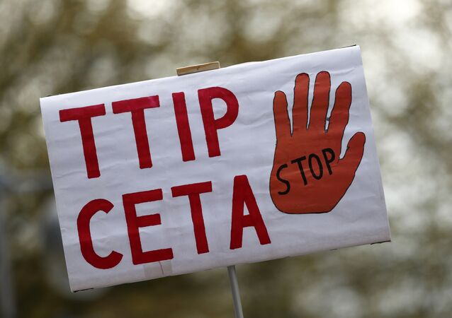 A placard against Comprehensive Economic and Trade Agreement (CETA) and Transatlantic Trade and Investment Partnership (TTIP) agreements.