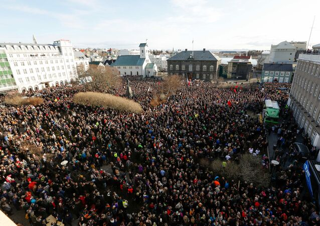 This is a Monday April 4, 2016 file photo of people who gathered to demonstrate against Iceland's prime minister, in Reykjavik. Iceland's president on Tuesday April 5, 2016, refused a request from the prime minister to dissolve parliament and call a new election amid a dispute over the premier's offshore tax affairs