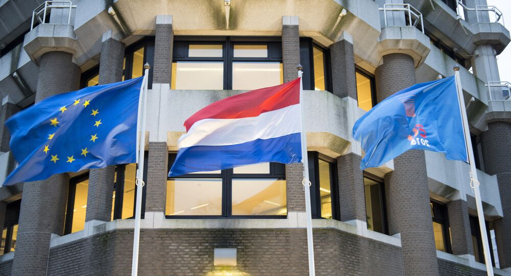 In front of the Dutch ministry of Foreign Affairs: the flag of the European Union, the flag of the Netherlands and a flag with the logo of the Dutch EU presidency