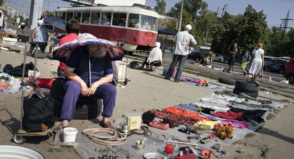 People sell objects at a city flea market in Ukraine's capital Kiev (File)