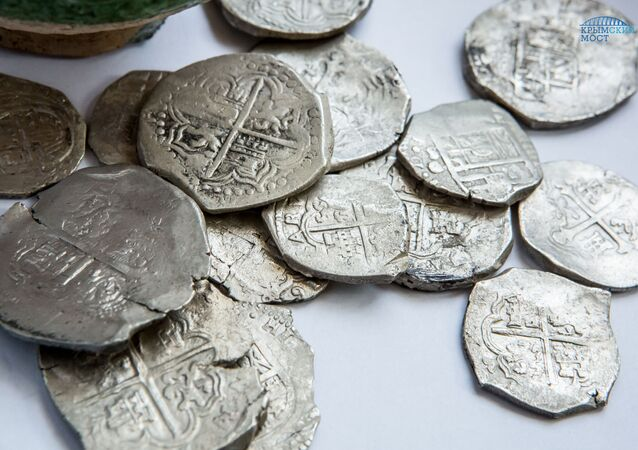 A trove of silver coins has reportedly been discovered by archaeologists at the construction site of a road which will link mainland Russia with Crimea