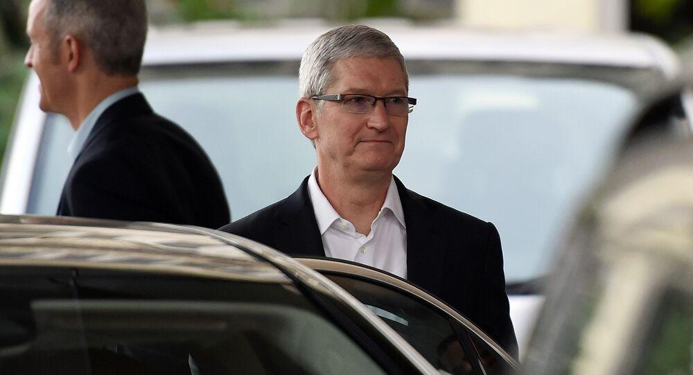 Apple chief executive Tim Cook (C) leaves the Taj Mahal Palace hotel in Mumbai on 18 May 2016