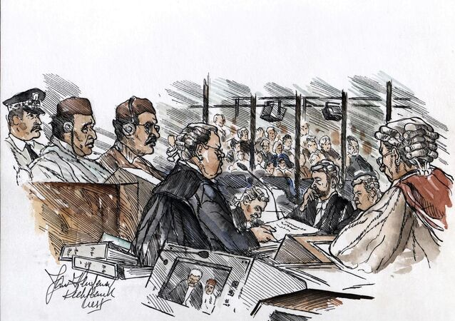 William Taylor (C), the lawyer of Libyan suspect Abdel Basset al-Megrahi (3rdL), flanked by suspect Lamen Khalifa Fhimah (2ndL), delivers his closing argument for the defence to the court presided by Lord Sutherland (R) at Camp Zeist, Netherlands, 11 January 2001.