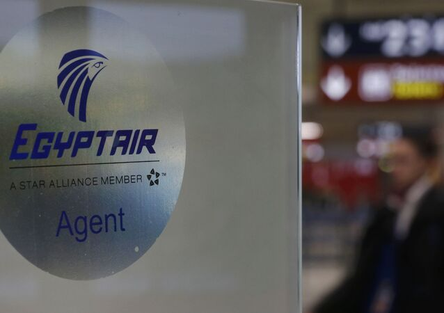 A man passes the Egyptair desk at Charles de Gaulle airport, after an Egyptair flight disappeared from radar during its flight from Paris to Cairo, in Paris, France, May 19, 2016
