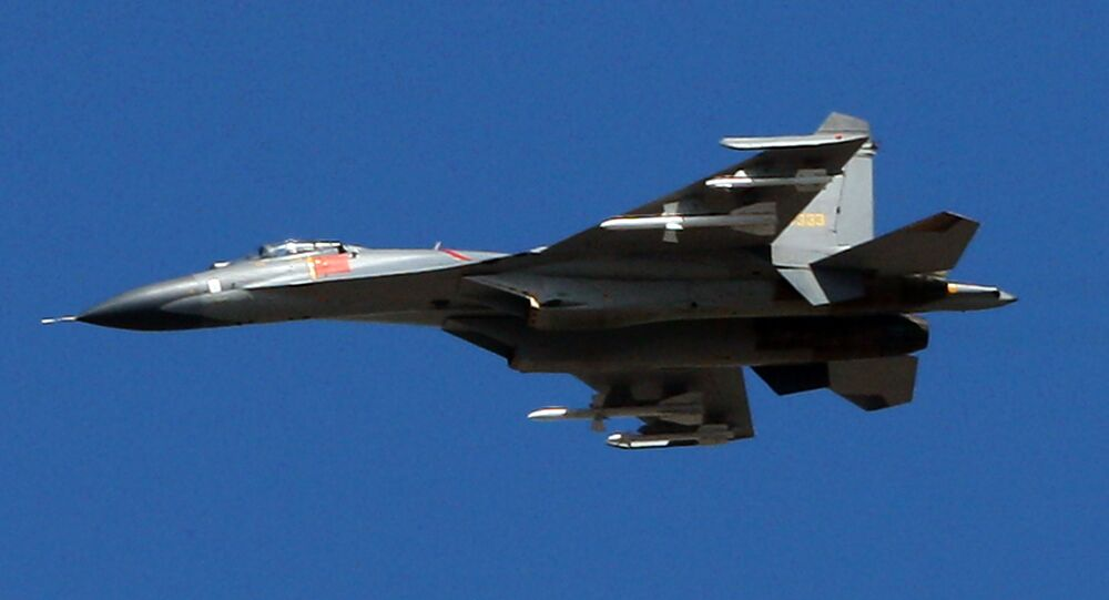 The latest Chinese Jian-series fighter jet executes a fly-by over Beijing on September 12, 2009 during a rehearsal for National Day
