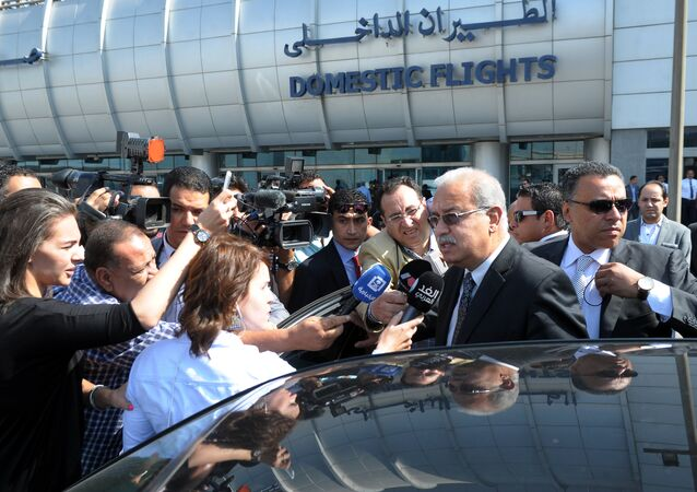 Egyptian Prime Minister Sherif Ismail talks to reporters at Cairo International Airport, Thursday, May 19, 2016