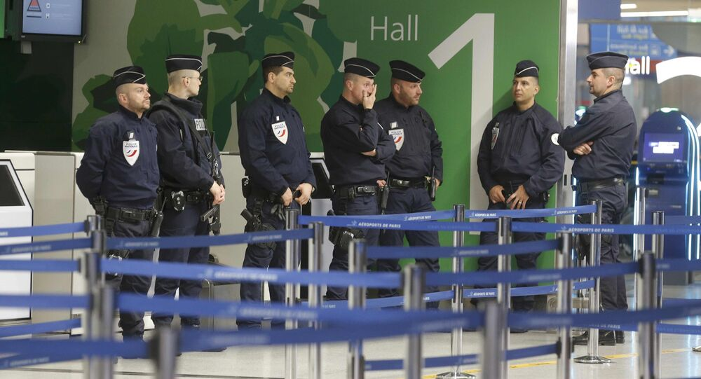 Police take up position at terminal 1 at Charles de Gaulle airport, after an Egyptair flight disappeared from radar during its flight from Paris to Cairo, in Paris, France, May 19, 2016