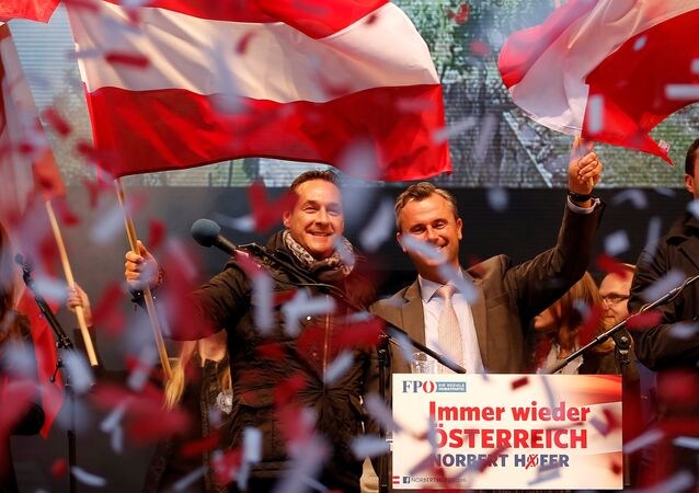 Austrian far right Freedom Party presidential candidate Norbert Hofer (R) and party leader Heinz-Christian Strache wave with Austrian flags during the final election rally in Vienna, Austria, April 22, 2016. Picture taken April 22, 2016.