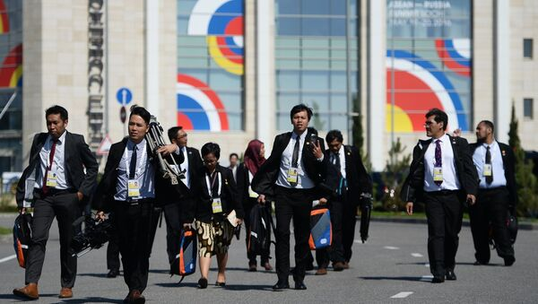 Journalists working at the International Press Centre for the ASEAN-Russia Summit near the congress centre in Sochi - Sputnik International