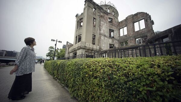 Kimie Mihara, a survivor of the 1945 atomic bombing, looks at the Atomic Bomb Dome, as it is known today in Hiroshima. - Sputnik International