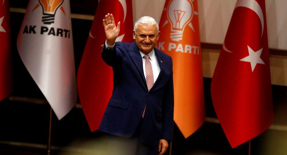 Binali Yildirim greets party members during a meeting in Ankara, Turkey, May 19, 2016