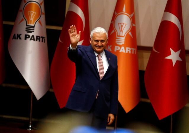 Binali Yildirim greets party members during a meeting in Ankara, Turkey, May 19, 2016