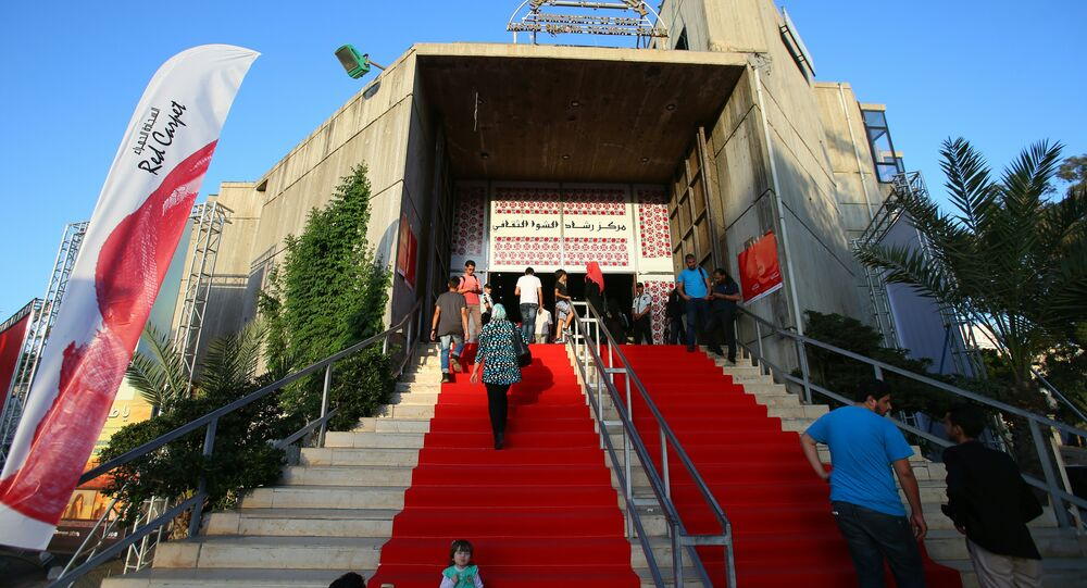 Palestinians arriving for the opening of the Red Carpet cinema festival in Gaza City, on May 12, 2016.