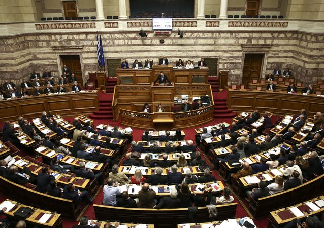 Greece's Prime Minister Alexis Tsipras addresses lawmakers during a parliamentary session in Athens.