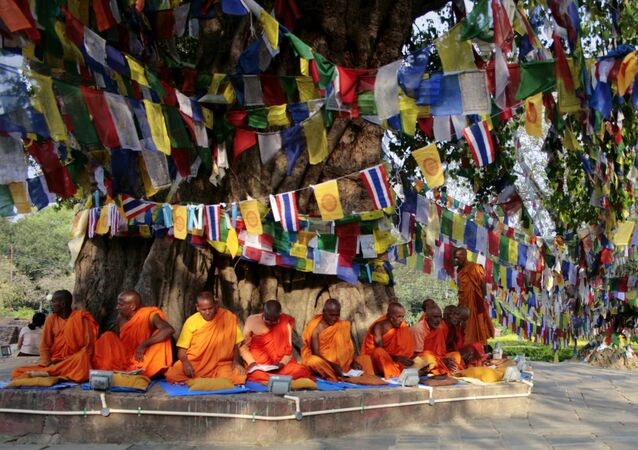 Monks chant as they sit under the Bodhi tree adjacent to the Maya Devi Temple in Lumbini. (File)