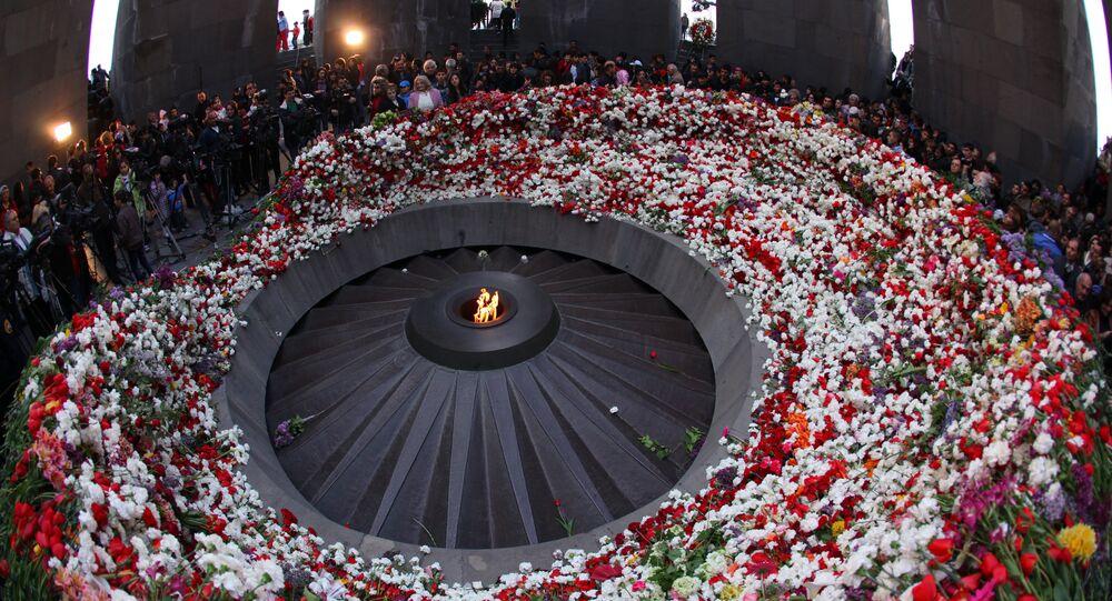 Residents of Yerevan and Armenian regions lay flowers to the Eternal Flame at the Tsitsernakaberd Armenian Genocide memorial in Yerevan