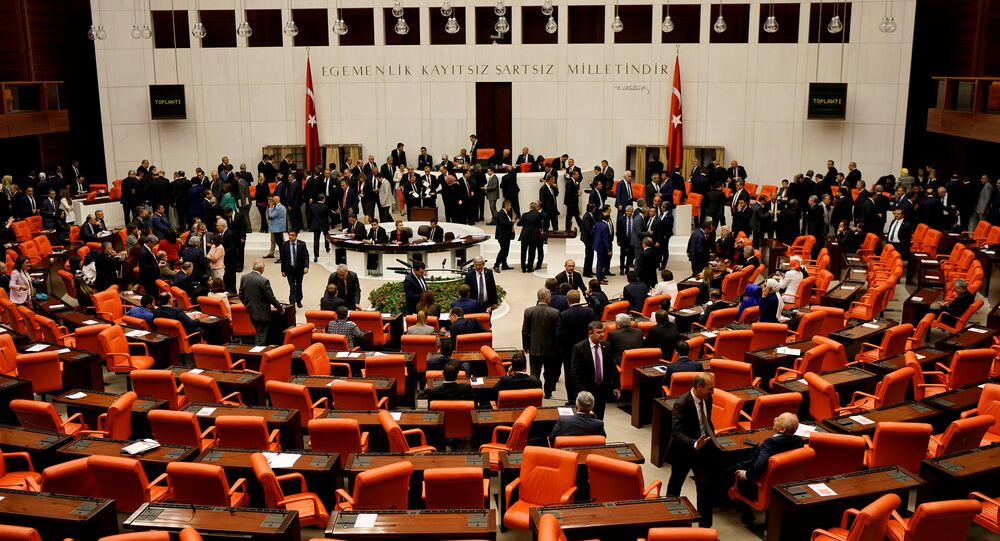 Turkish lawmakers attend a debate at the Turkish parliament in Ankara, Turkey, May 20, 2016.