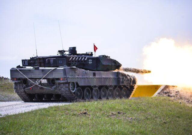 German Bundeswehr soldiers fire at their target.