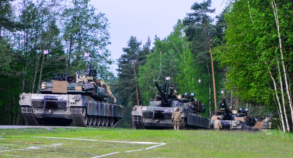 U.S. Soldiers, assigned to the 3rd Infantry Division, prepare their Tanks.