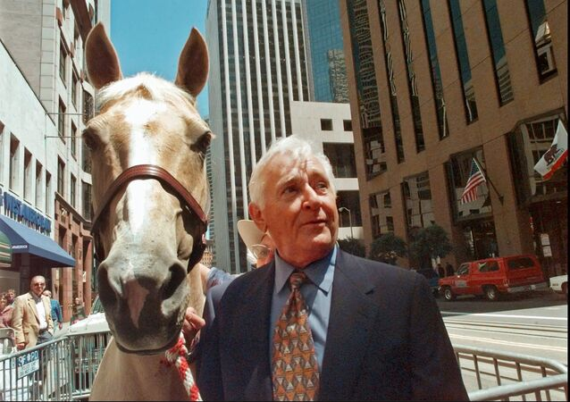 In this July 31, 1997 file photo, actor Alan Young of the Mister Ed television series, poses with Mister Ed-For-A-Day, Champagne, a 13-year-old Palomino mare, in San Francisco.