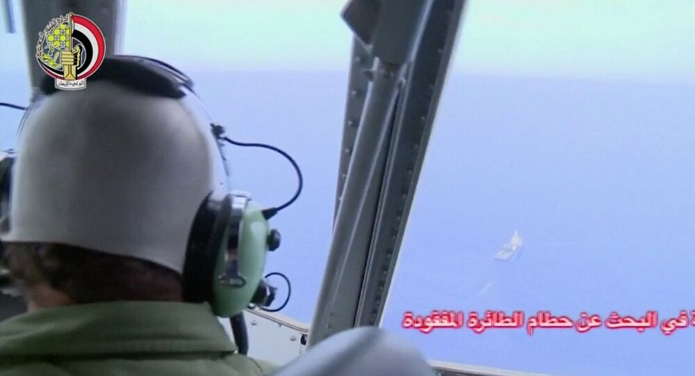 A pilot looks out of the cockpit during a search operation by Egyptian air and navy forces for the EgyptAir plane that disappeared in the Mediterranean Sea, in this still image taken from video May 20, 2016.