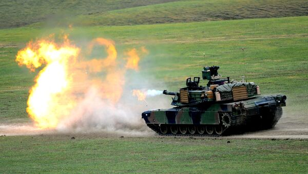A US M1A2 Abrams tank fires during the Noble Partner 2016 joint military exercise at the Vaziani training area outside Tbilisi on May 18, 2016. - Sputnik International