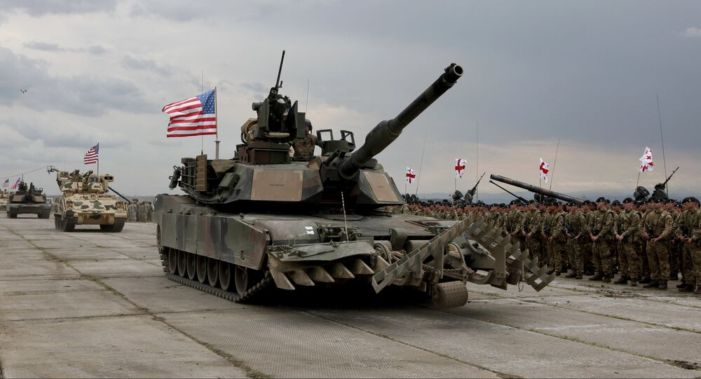 U.S servicemen drive their armored vehicles at the opening ceremony of U.S, British and Georgian troops joint military exercises at the Vaziani military base outside Tbilisi, Georgia, Wednesday, May 11, 2016.