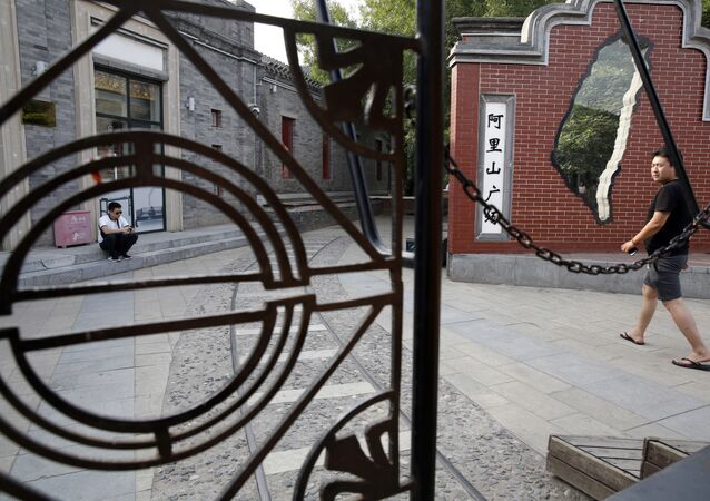 A man walks past a little used Taiwan themed retail district with an outline of the Taiwan island in Beijing Friday