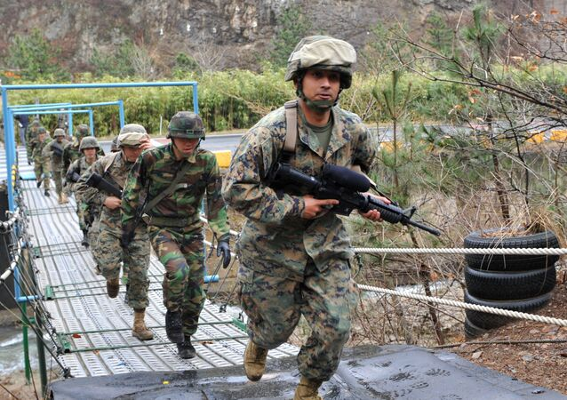US and South Korean marines cross a bridge during mountain warfare drills in Pohang, about 370 km (230 miles) southeast of Seoul