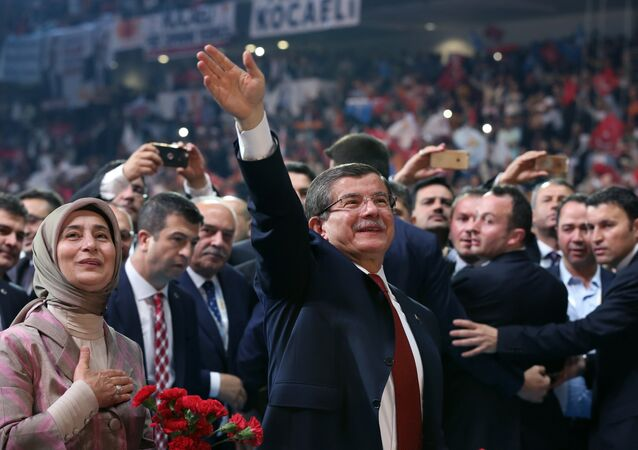 Head of the governing Justice and Development Party and Prime Minister Ahmet Davutoglu with his wife Sare Davutoglu, left, waves towards supporters during the party congress in Ankara, Turkey, Sunday, May 22, 2016.
