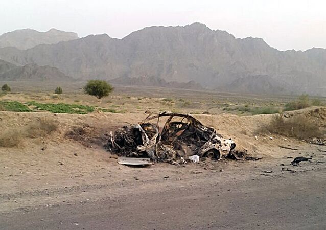 This photo taken by a freelance photographer Abdul Salam Khan using his smart phone on Sunday, May 22, 2016, purports to show the destroyed vehicle in which Mullah Mohammad Akhtar Mansour was traveling in the Ahmad Wal area in Baluchistan province of Pakistan, near Afghanistan's border.
