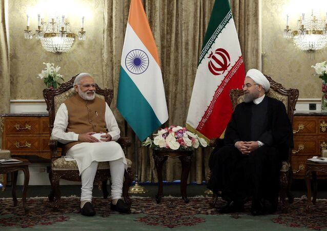 Iran's President Hassan Rouhani (R) meets India's Prime Minister Narendra Modi in Tehran, Iran May 23, 2016.