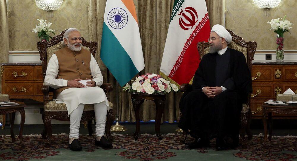 Iran's President Hassan Rouhani (R) meets India's Prime Minister Narendra Modi in Tehran, Iran May 23, 2016.