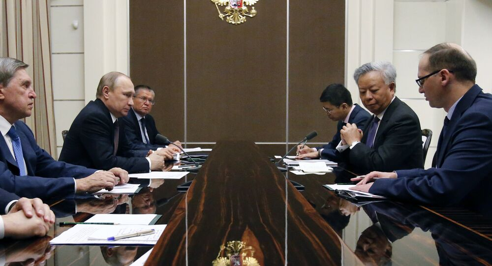 Russian President Vladimir Putin (2nd L) meets with Asian Infrastructure Investment Bank President Jin Liqun (2nd R) at the Bocharov Ruchei state residence in Sochi on May 18, 2016.