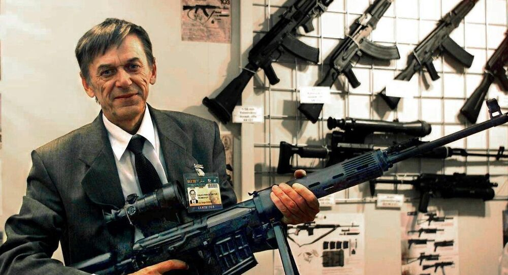 Victor Kalashnikov, the son of Russian Mikhail Kalashnikov, the inventor of the famous assault rifle, shows off a model of his own pistol machinegun, the Bizon-2, which is to equip Russia's police force
