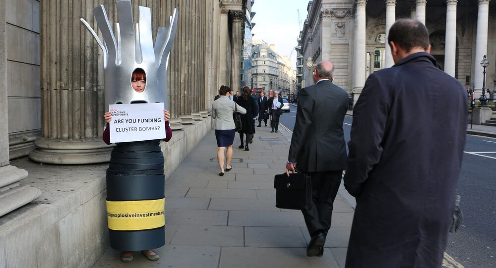 A campaigner dressed as a cluster bomb in London, UK.