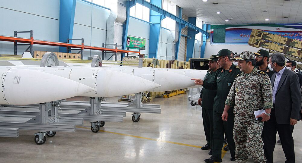 Iran's Defence Minister Hossein Dehqan (2nd L) pointing at an anti-missile system missiles of Sayyad-2 (Hunter 2), during the inauguration of it's production line in Tehran on November 9, 2013