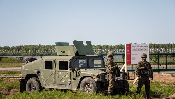 Soldiers stand guard during ground breaking ceremony of the northern section of defence anti-missile shield in Redzikowo military base in northern Poland - Sputnik International