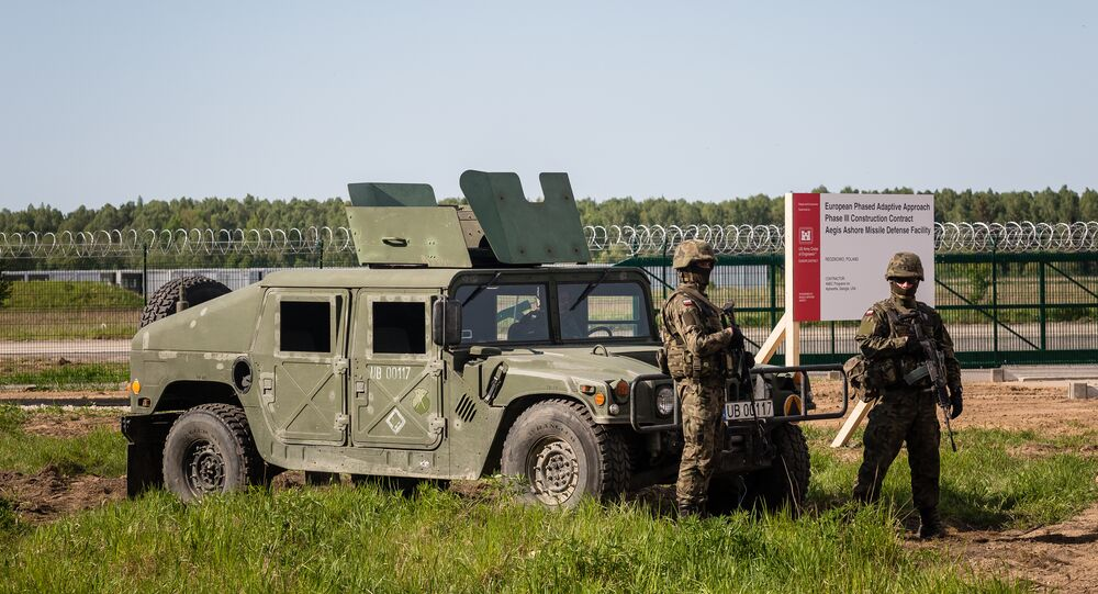 Soldiers stand guard during ground breaking ceremony of the northern section of defence anti-missile shield in Redzikowo military base in northern Poland