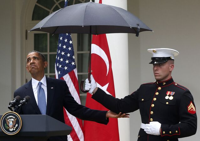 President Barack Obama looks to see if it is still raining as a Marine holds an umbrella for him during his joint news conference with Turkish President Tayyip Erdogan (File)