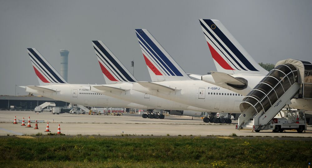 Air France planes are parked on the tarmac of Charles de Gaulle airport on September 24, 2014 in Roissy during an Air France pilots strike