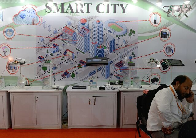 An Indian delagate talks on a phone during the Smart Cities India 2016 expo in New Delhi on May 12, 2016