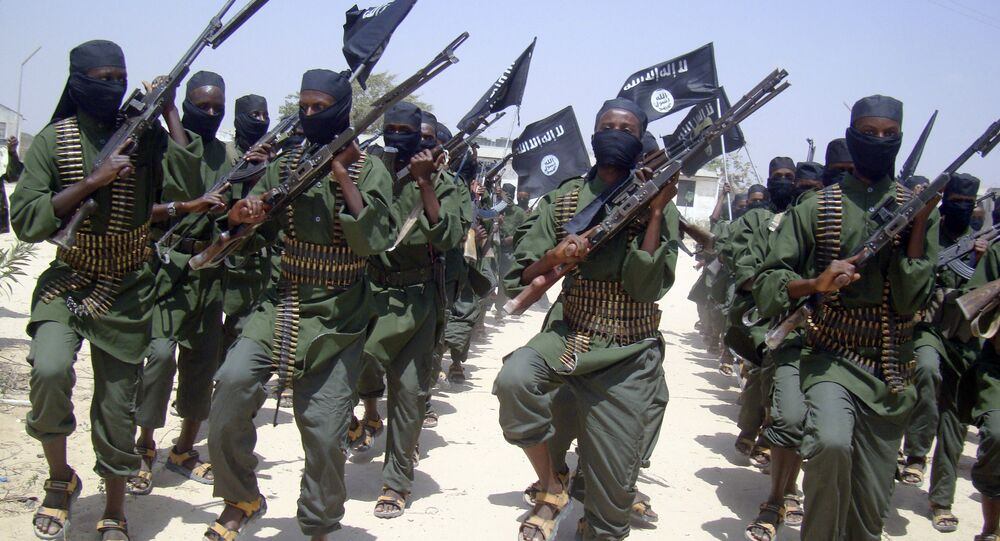 In this Thursday, Feb. 17, 2011 file photo, al-Shabab fighters march with their weapons during military exercises on the outskirts of Mogadishu, Somalia