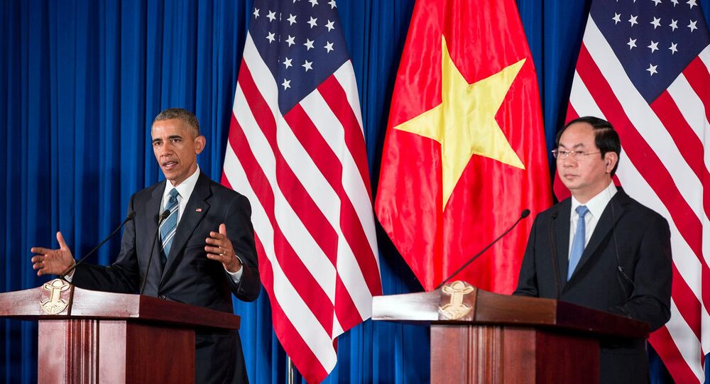 Barack Obama in a press conference with Vietnam's President Tran Dai Quang