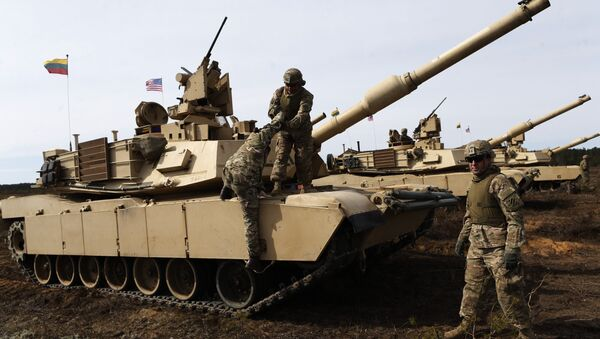 U.S. soldiers from the 2nd Battalion, 1st Brigade Combat Team, 3rd Infantry Division at the M1A2 Abrams battle tank during a military exercise at the Gaiziunu Training Range in Pabrade some 60km.(38 miles) north of the capital Vilnius, Lithuania - Sputnik International