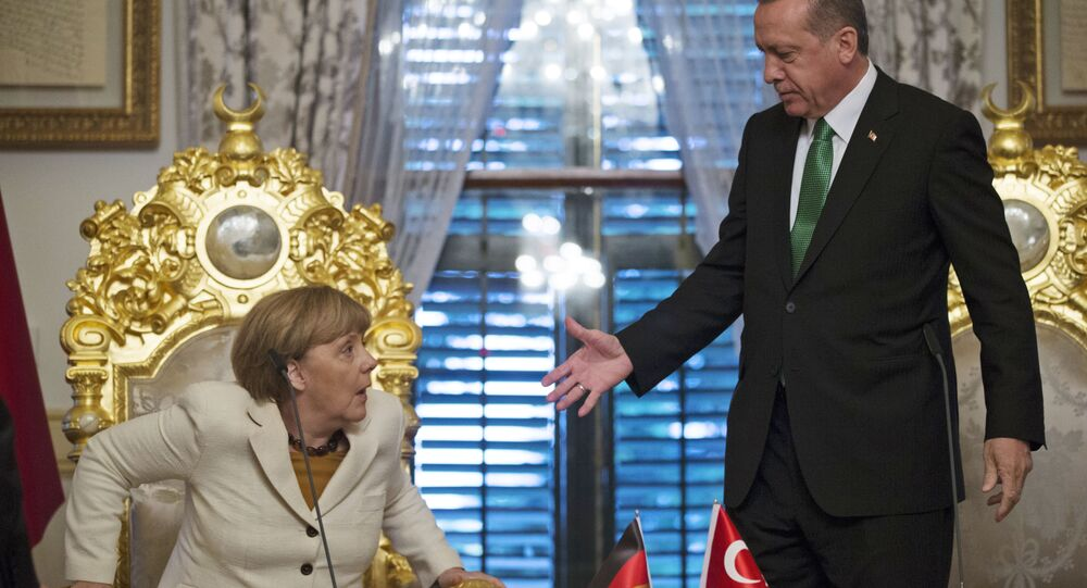 Turkish President Recep Tayyip Erdogan, right, offers his hand to shake hands with Germany's Chancellor Angela Merkel (File)