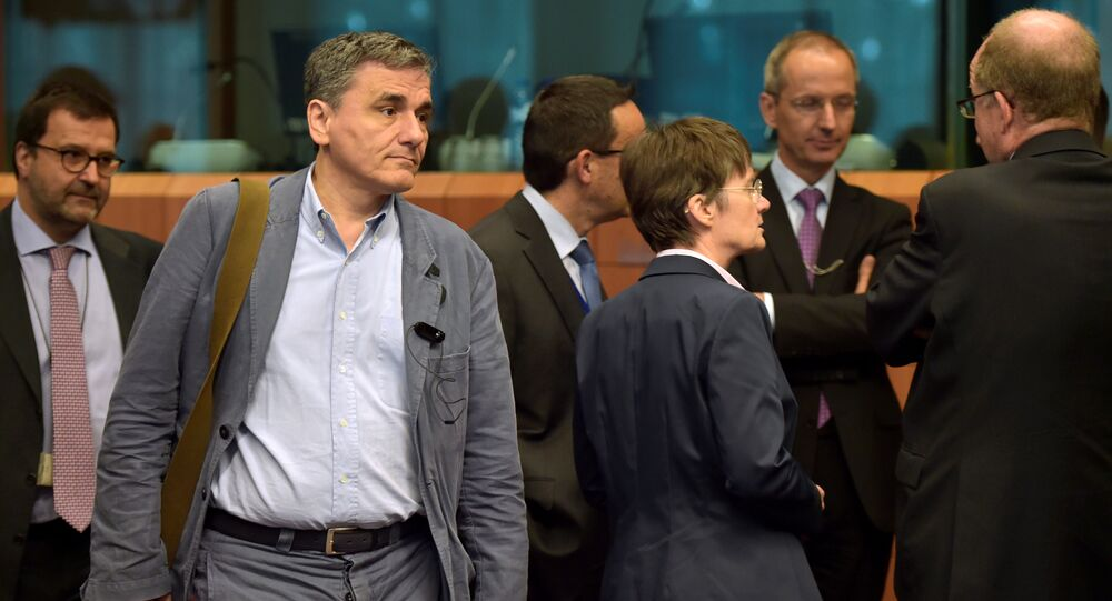 Greece's finance Minister Euclid Tsakalotos arrives at a Euro zone finance ministers meeting to discuss whether Greece has passed sufficient reforms to unblock new loans and how international lenders might grant Athens debt relief, in Brussels, Belgium May 24, 2016.