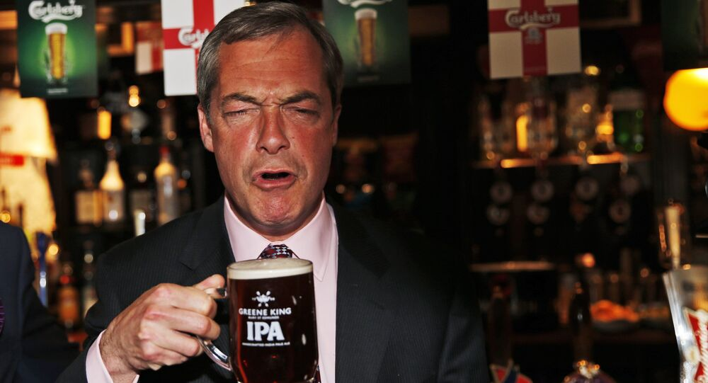 In this Friday, May 23, 2014 file photo, Nigel Farage, leader of Britain's United Kingdom Independence Party (UKIP) enjoys a pint of beer in South Benfleet, England.