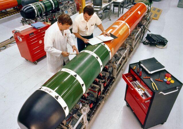 Technicians perform maintenance on a Mark 48 advanced capabilities torpedo at Keyport, Washington